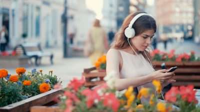 Young girl listening to music outdoors